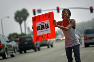 Cherise Rogers (ME), 27, of Hawthorne, standing on Pacific Coast Highway at Webb Way in Malibu, was among the volunteers helping get the word out Saturday about the search for Mitrice Richardson, 24, who disappeared Sept. 17 after being released from a sheriff's substation in Calabasas. More photos >>> (Jay L. Clendenin / Los Angeles Times / September 27, 2009)